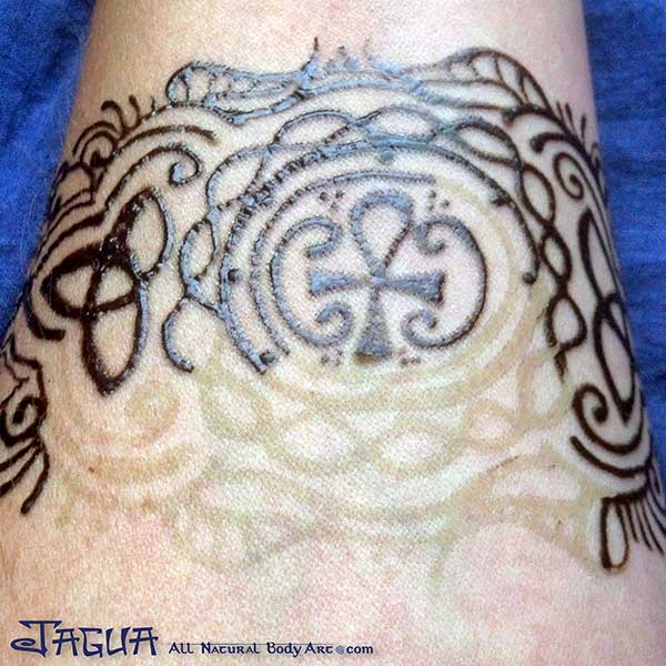 Jagua all natural body art temporary blue black tattoos for Removal of temporary tattoos